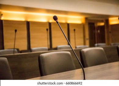 Conference table microphone and office chairs and meeting room for background