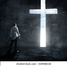 Confess to Jesus concept: Silhouettes black and white humble man hands down and stand up over cross in dark room background