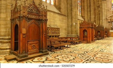 Confession booths at Duomo in Milan, Italy