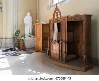 Confessional in Catholic cathedral. Church of Sts. Olha and Elizabeth in Lviv, Ukraine