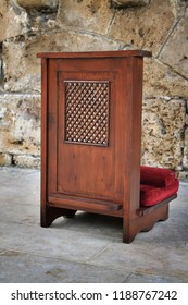 A confessional chair put outside the church.