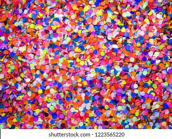 Confetti diversity background, large size. Texture colored circles from paper, close-up. Basis for a festive design or a postcard. Carnival, abstract wedding or birthday backdrop