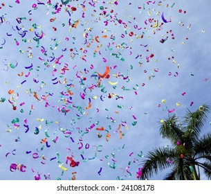 Confetti on the air against blue sky