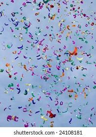 Confetti on the air against blue sky
