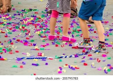 Confetti on the floor and children playing
