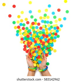 Confetti scattered in different colors on a white background. Festive confetti. The decor for the party.