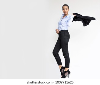 confidence action portrait model asian lady in business look with blue shirt on gray and swing her suite on background