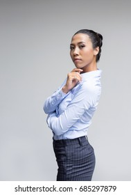 confidence action portrait model asian lady in business look with blue shirt on gray background