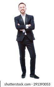 Confidence and charisma. Full length of smiling young bearded man in formalwear keeping arms crossed and looking at camera against white background