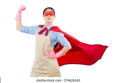 confidence superhero house cleaner showing her powerful muscle arm with wearing red cloak and goggles. isolated on white background. housework and household concept.