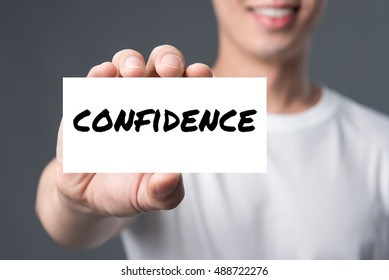 CONFIDENCE word on the card shown by smiling man