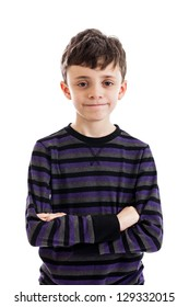 Confident 9 year old boy with arms folded portrait isolated on a white background
