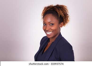 Confident African American business woman portrait, isolated on gray background