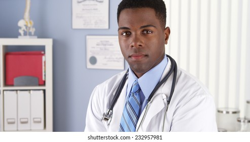 Confident African American doctor in clinic