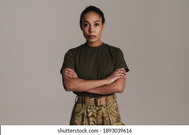 Confident african american soldier woman posing with arms crossed isolated over grey wall - Shutterstock ID 1893039616