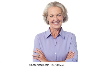 Confident aged woman smiling to camera