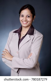 Confident arms crossed young Indian business woman