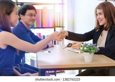 Confident Asian business female shaking hands with partners after finishing a meeting. Handshake greeting deal concept.