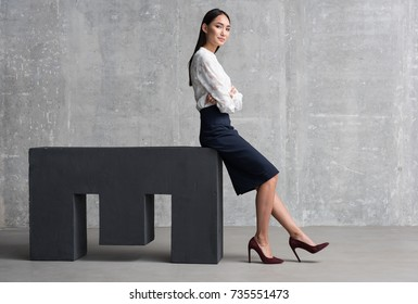 Confident asian woman achieving business success