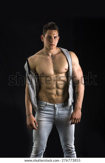 Confident, Attractive Young Man With Open Vest On Stock