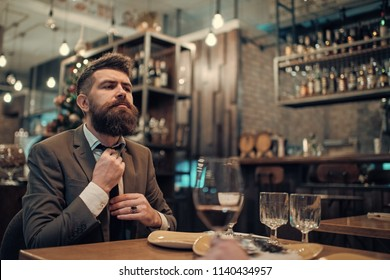 Confident bar customer speak in cafe. Business on go and communication. Date or business meeting of hipster in pub. Businessman with long beard in cigar club. Bearded man in restaurant with companion