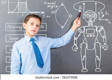 Confident boy demonstrating his knowledge in robotics