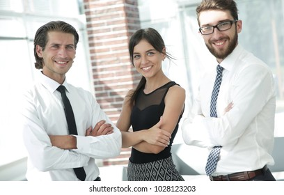 confident business colleagues in the background of the office