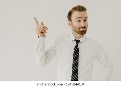 Confident business expert catching new idea, inventing solution. Red hared man in white shirt and tie pointing finger up. New idea or problem solving concept