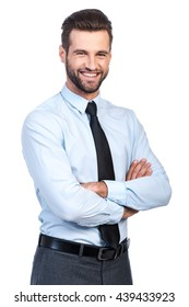 Confident business expert. Confident young handsome man in shirt and tie keeping arms crossed and smiling while standing against white background
