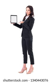 Confident business female assistant presenting white blank computer tablet screen with copyspace. Full body isolated on white background.