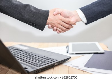 confident business man shaking hands during a meeting to aim dealing success and partner concept in the office .