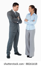 Confident business partner looking at each other against a white background