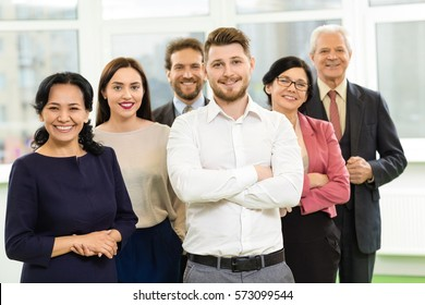 Confident business people. Multiethnic diverse business team posing together at the office confident cheerful businesspeople colleagues smiling to the camera teamwork partnership professionalism group