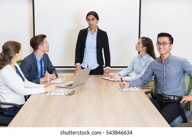 Confident business team with female leader
