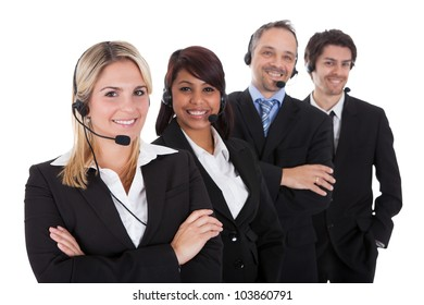 Confident business team with headset standing in a line against white background