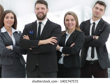 confident business team on the background of the office