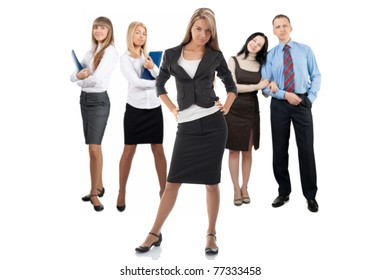 Confident business woman with colleagues standing in the background. Isolated on white