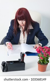 Confident business woman with documents sitting in a comfortable modern office