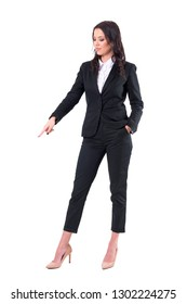 Confident business woman pointing finger down showing empty copy space. Full body isolated on white background.
