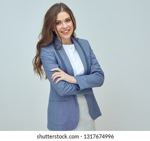 Confident business woman posing with crossed ams.
