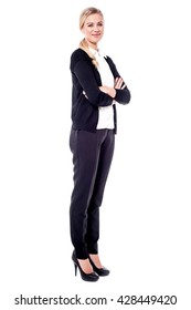 Confident business woman standing full length in black suit