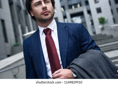 Confident businessman in city view