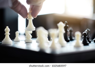 Confident businessman colleagues playing chess game overcome the fear of confrontation to development analysis new strategy plan, leader and teamwork concept for success.