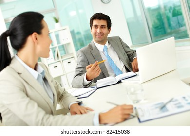 Confident businessman explaining his ideas to colleague at meeting