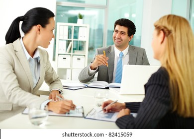 Confident businessman explaining his ideas to colleagues at meeting