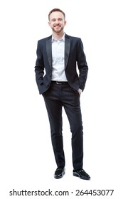 Confident businessman. Full length of handsome young bearded man holding hands in pockets and looking at camera isolated on white