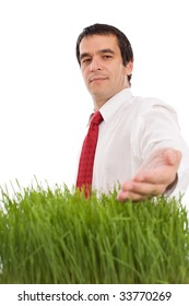 Confident businessman with grass - green environmental business concept, isolated
