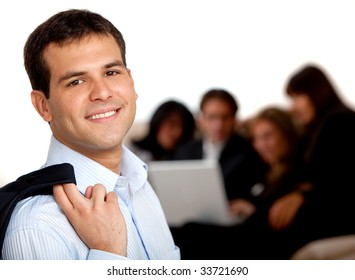 Confident businessman with a group behind, isolated