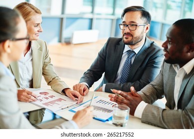 Confident businessman looking at his colleagues at meeting