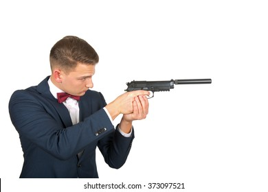 Confident businessman pointing a gun on isolated background